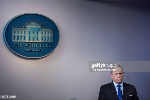 White House press secretary Sean Spicer listens as Commerce Secretary Wilbur Ross speaks to the media during the daily briefing in the Brady Press...