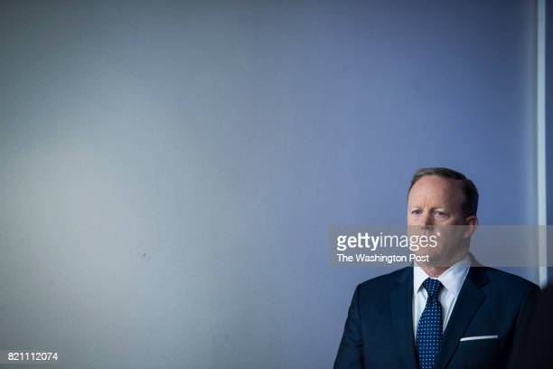 White House press secretary Sean Spicer listens as EPA Administrator Scott Pruitt speaks during the daily briefing in the Brady Press Briefing Room...