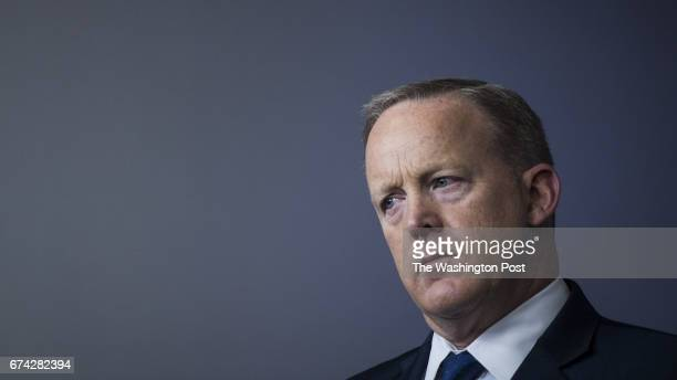 White House press secretary Sean Spicer listens as National Economic Director Gary Cohn joined by Treasury Secretary Steven Mnuchin speaks during a...