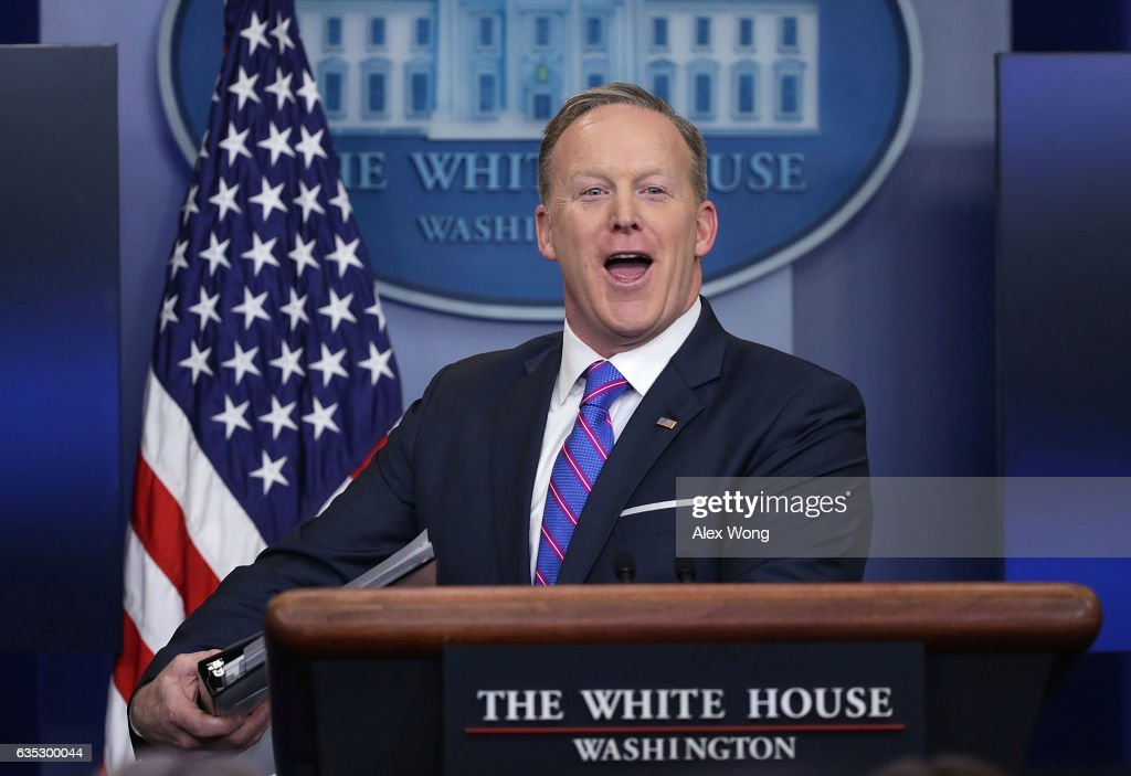 White House Press Secretary Sean Spicer smiles as he wraps up a daily press briefing at the James Brady Press Briefing Room February 14, 2017 at the White House in Washington, DC. Spicer discussed on various topics including the resignation of Michael Flynn from his position as National Security Adviser.