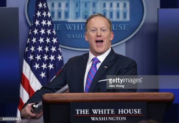 White House Press Secretary Sean Spicer smiles as he wraps up a daily press briefing at the James Brady Press Briefing Room February 14 2017 at the...