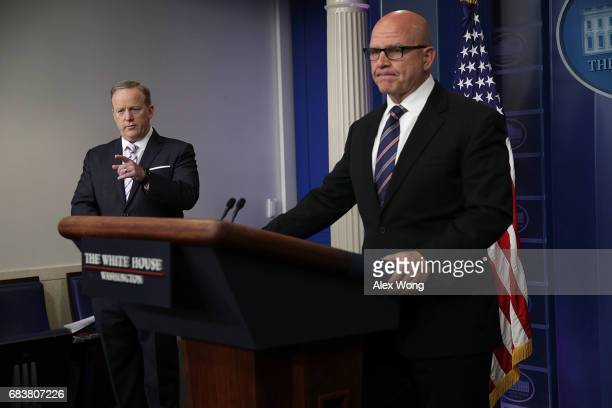 White House Press Secretary Sean Spicer takes question as National Security Advisor HR McMaster listens during press briefing at the James Brady...