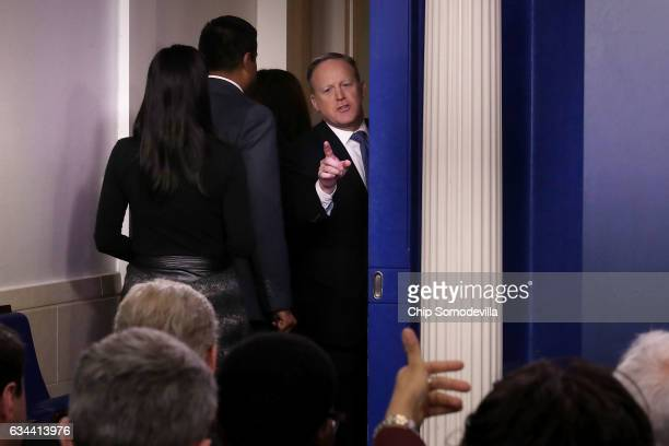 White House Press Secretary Sean Spicer turns to answer reporters' questions after leaving the Brady Press Briefing Room at the White House February...