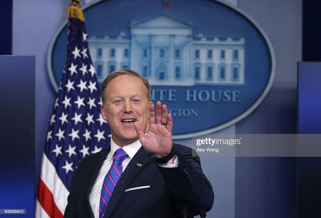 White House Press Secretary Sean Spicer waves as he leaves after a daily press briefing at the James Brady Press Briefing Room February 14, 2017 at the White House in Washington, DC. Spicer discussed on various topics including the resignation of Michael Flynn from his position as National Security Adviser.