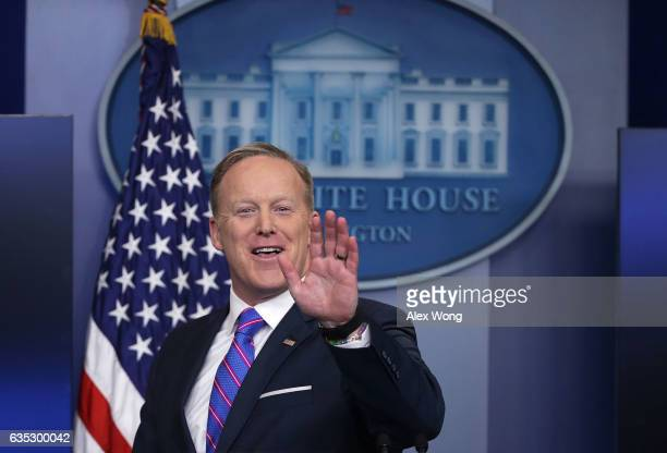 White House Press Secretary Sean Spicer waves as he leaves after a daily press briefing at the James Brady Press Briefing Room February 14 2017 at...