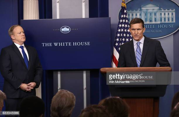White House Press Secretary Sean Spicer yields the briefing room podium to National Security Adviser Michael Flynn February 1 2017 in Washington DC...
