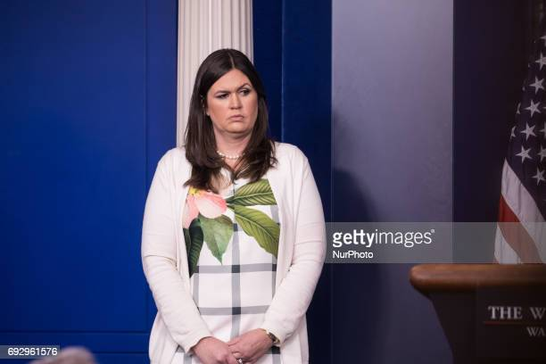 White House Principal Deputy Press Secretary Sarah Huckabee Sanders listens to Scott Pruitt EPA Administrator deliver the press briefing in the James...
