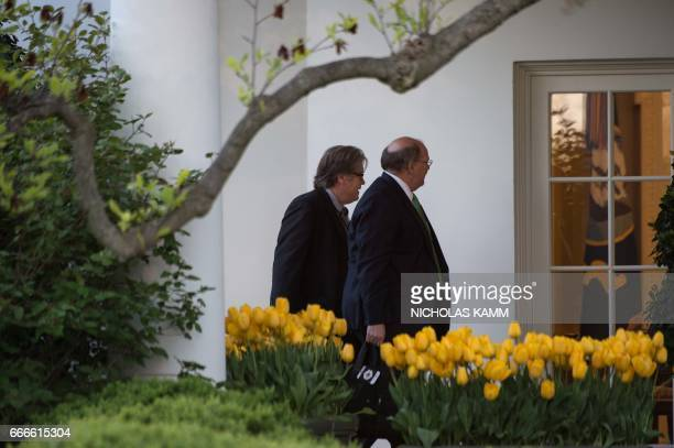 White House senior adviser Steve Bannon and Deputy Chief of State Joe Hagin walk to the West Wing of the White House in Washington DC on April 9 2017...