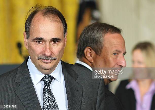White House senior advisor David Axelrod and outgoing Director of the White House National Economic Council Larry Summers arrive in the East Room for...