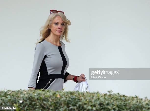 White House senior advisor Kellyanne Conway walks along the colonnade before President Donald Trump's departure from the South Lawn on February 17...