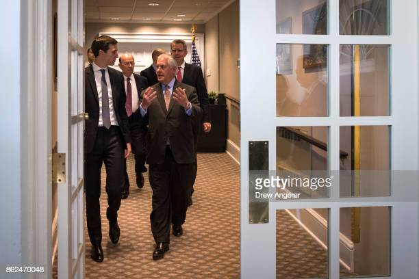 White House Senior Advisor to the President Jared Kushner and US Secretary of State Rex Tillerson exit the West Wing as they arrive for a joint press...