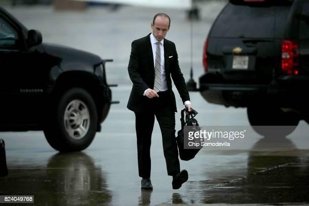 White House Senior Advisor to the President Stephen Miller walks across the tarmac July 28 2017 in Joint Base Andrews Maryland President Donald Trump...