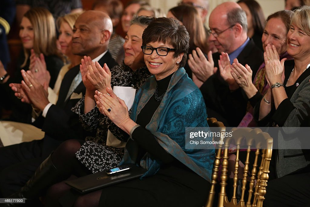 White House Senior Advisor Valerie Jarrett applauds as US first lady Michelle Obama and President Barack Obama announce a new governmentwide...