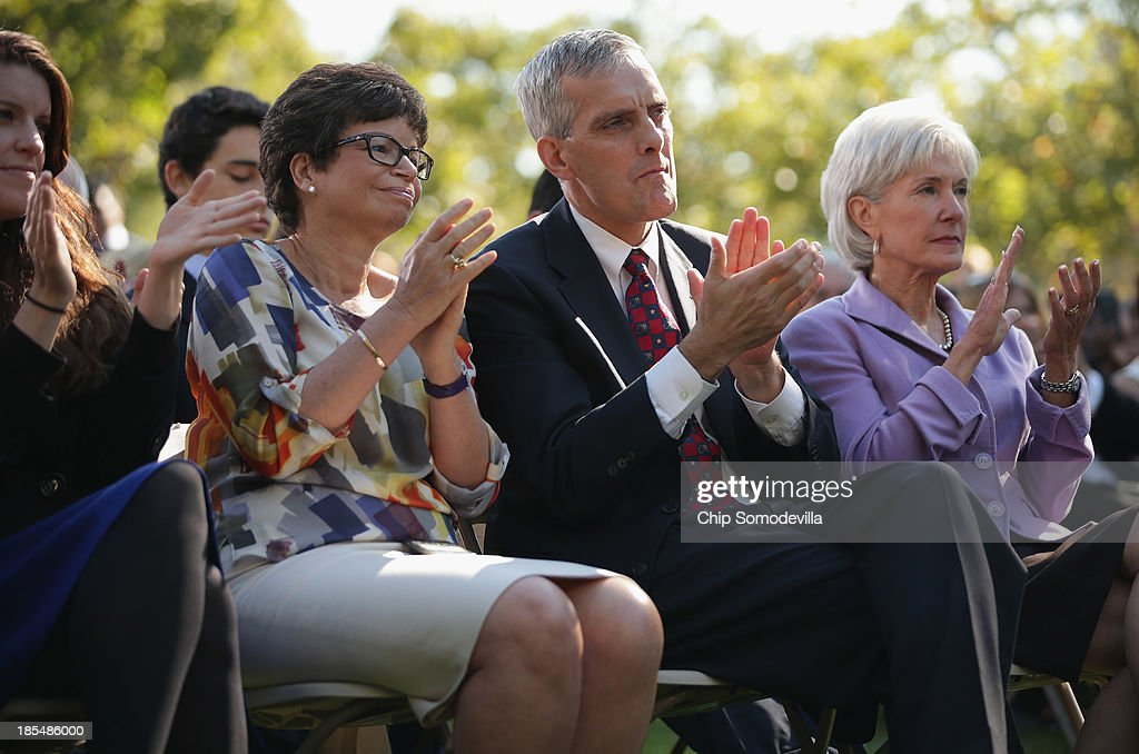 White House Senior Advisor <a gi-track='captionPersonalityLinkClicked' href=/galleries/search?phrase=Valerie+Jarrett&family=editorial&specificpeople=5003206 ng-click='$event.stopPropagation()'>Valerie Jarrett</a>, Chief of Staff Denis McDonough and Health and Human Services Secretary <a gi-track='captionPersonalityLinkClicked' href=/galleries/search?phrase=Kathleen+Sebelius&family=editorial&specificpeople=700528 ng-click='$event.stopPropagation()'>Kathleen Sebelius</a> applaud during President Barack Obama speech about the error-plagued launch of the Affordable Care Act's online enrollment website in the Rose Garden of the White House October 21, 2013 in Washington, DC. According to the White House, the president was joined by 'consumers, small business owners, and pharmacists who have either benefitted from the health care law already or are helping consumers learn about what the law means for them and how they can get covered. 'Despite the new health care law's website problems, Obama urged Americans not to be deterred from registering for Obamacare because of the technological problems that have plagued its rollout.