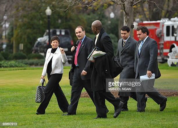 White House senior advisors Valerie Jarrett and David Axelrod and personal aide to the President Reggie Love walks with Deputy Press Secretary Bill...