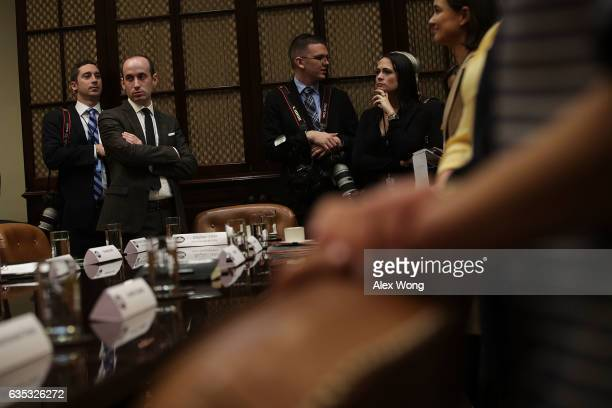 White House senior policy adviser Stephen Miller and Deputy Press Secretary Stephanie Grisham wait for the beginning of a parentteacher conference...