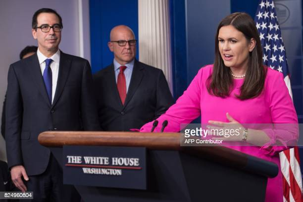 White House spokesman Sarah Huckabee Sanders speaks at the press briefing with US Treasury Secretary Steve Mnuchin and National Security Advisor HR...