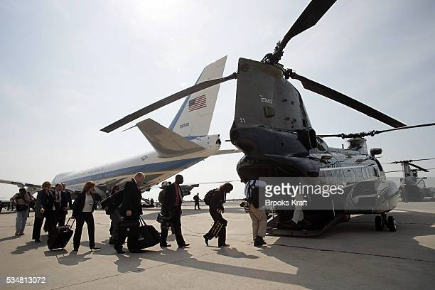 White House staff and press board military helicopters upon President Bush's arrival on Air Force One at JFK Airport in New York on September 18 2006...
