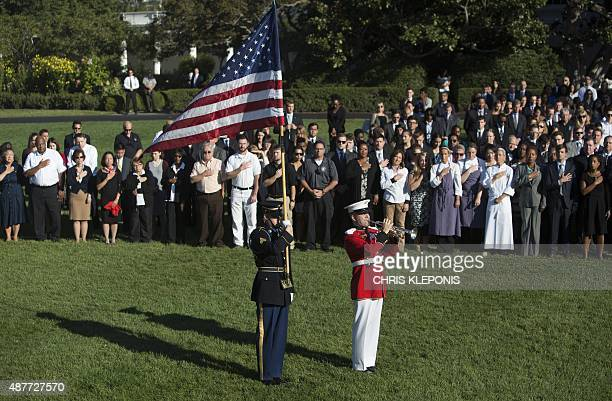 White House staff participates in a moment of silence at The White House in Washington DC September 11 2015 to mark the 14th anniversary of the 9/11...