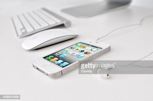 White iPhone 4 with headphones
