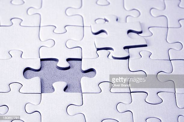 White jigsaw puzzle, one piece missing till the finish