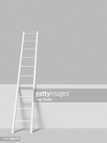 White ladder on a wall