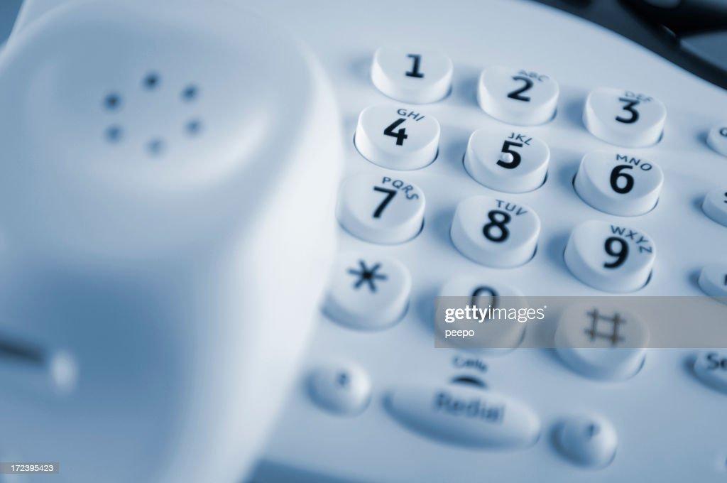 Bianco telefono fisso con tastiera come punto focale : Foto stock