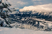 A snow covered white landscape in Anchorage,  Alaska in the town of Girdwood high Alaskan snow covered Mountains in winter wonderland