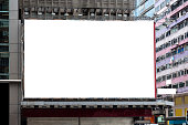 White large billboard for rent on building in downtown