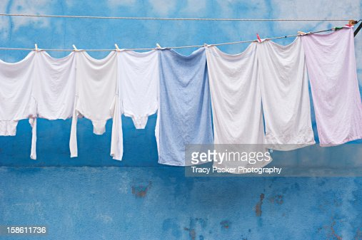 White Laundry hangs in front of a pale blue wall