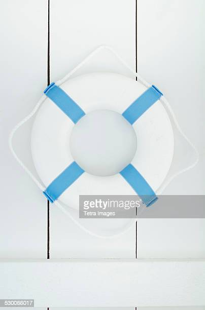 White lifebelt hanging on white wall