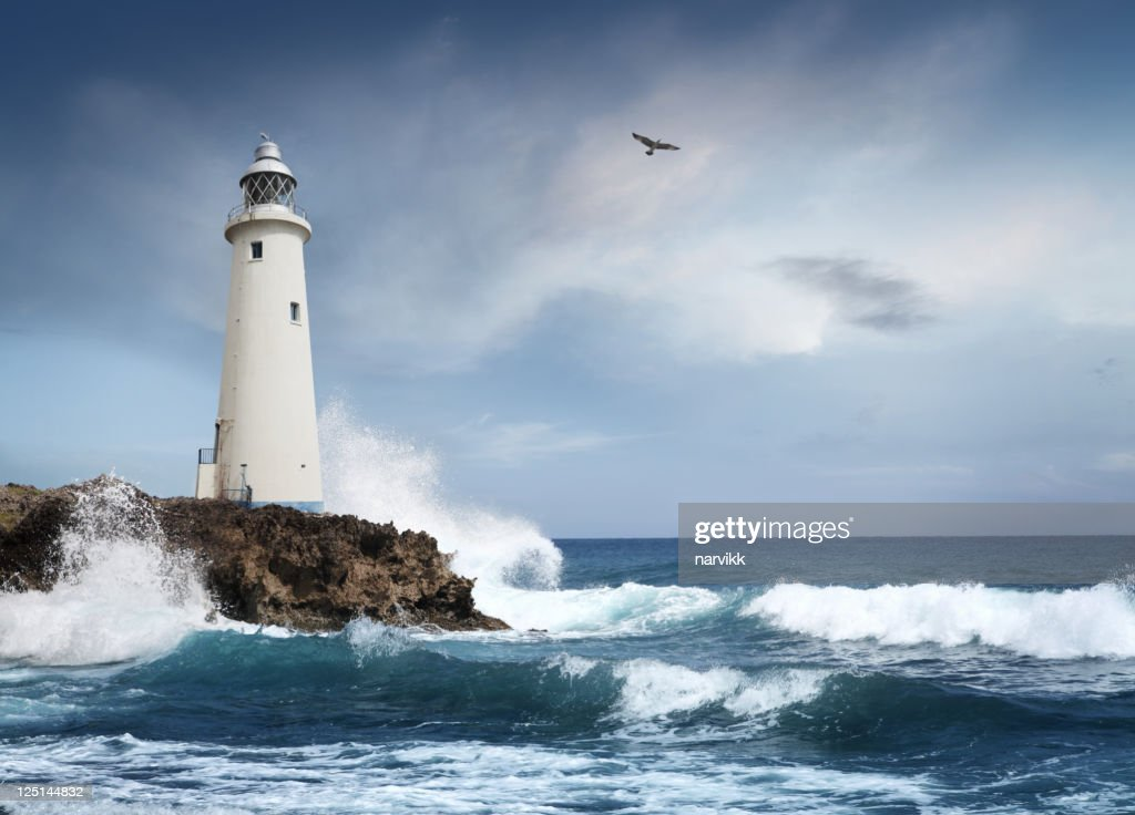 White lighthouse on the cliff : Stock Photo