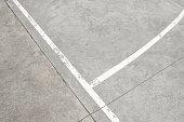 white lines on concrete floor - vintage sport field detail -