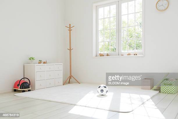 White living room with soccer ball on floor