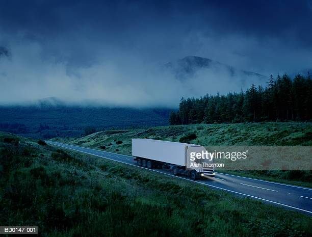 White lorry driving along country road at night (Digital Enhancement)