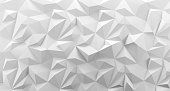 White low poly rock background texture. 3d rendering. Crumpled paper