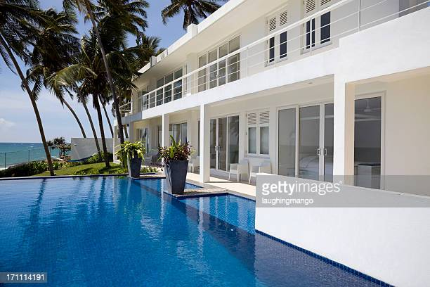 White luxurious villa in Sri Lanka with palm trees and pool