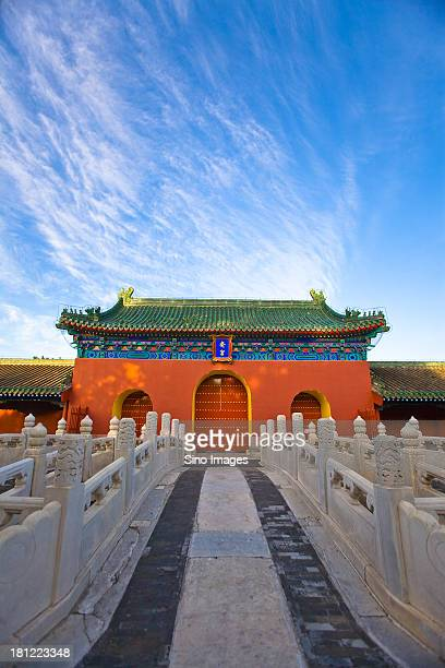 White marble arch in front and palace in the Temple of Heaven