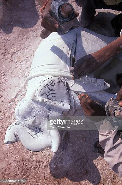 White marble elephant being carved, close-up, elevated view