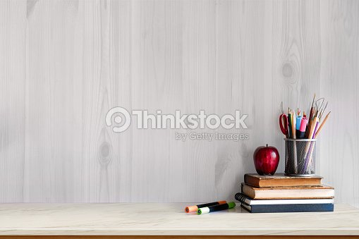 White marble table with vintage books, red fruit and supplies. Workspace with copy space for products display montage. mock up concept. : Stock Photo