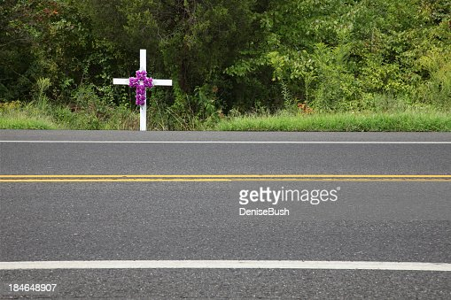 White memorial cross at the roadside