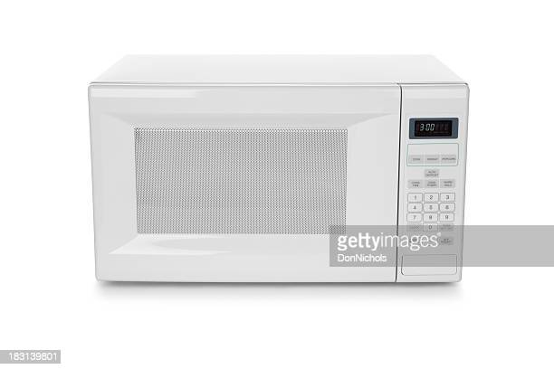 White microwave oven on white background