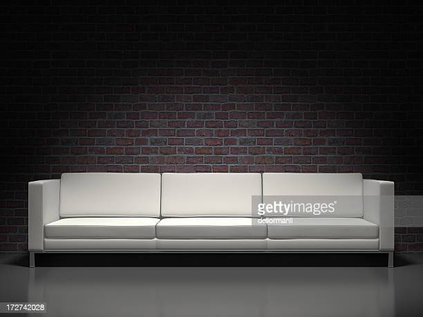 Weiße modernes sofa und brick background
