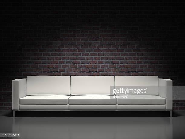 white modern sofa and brick background