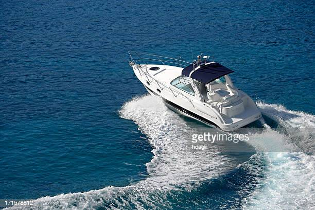 White motorboat making waves on blue water