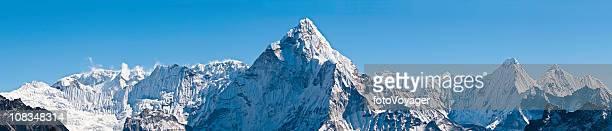 White mountain peaks pinnacles panorama dramatic snow summits Himalayas Nepal