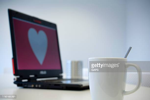 white mug and heart shape on a notebook