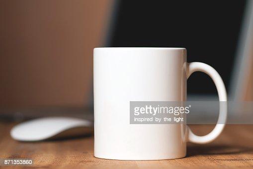 White mug on the desktop : Stock Photo