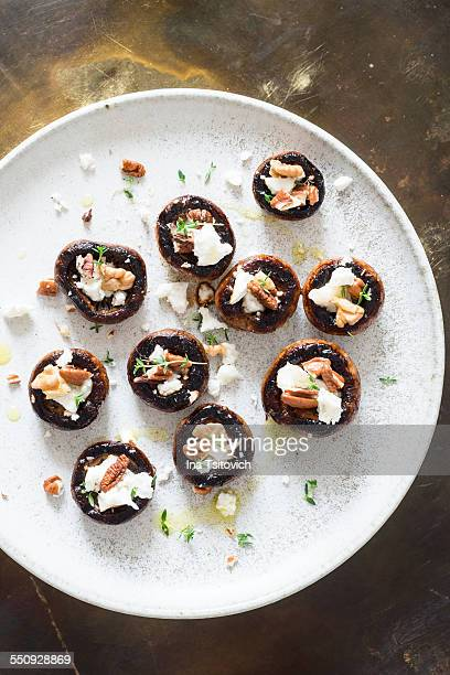 White mushrooms with goat cheese and nuts