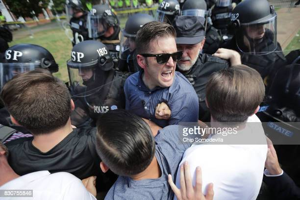 White nationalist Richard Spencer and his supporters clash with Virginia State Police in Emancipation Park after the 'Unite the Right' rally was...